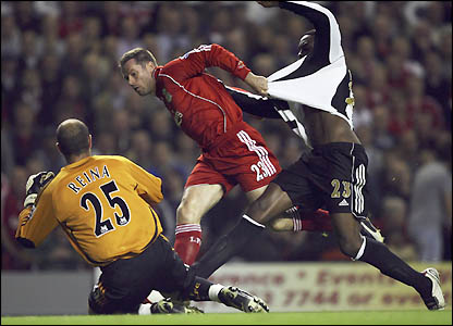 Shola Ameobi is kept at bay by the Liverpool defence