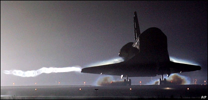 Shuttle lands at Kennedy Space Center  Image: AP