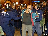 Hungarian riot police arrest a demonstrator in Budapest, 21 Sep 06