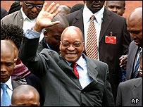 Former South Africa President Jacob Zuma waves to supporters outside the court in Pietermaritzburg, South Africa