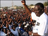 Patriotic Front Presidential candidate, Michael Sata gestures to supporters during a political rally