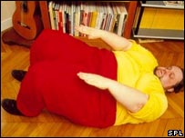 Image of an obese man exercising