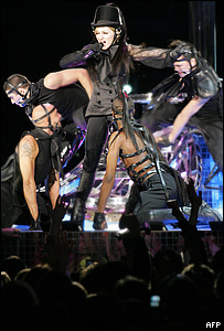 Madonna performing on tour with dancers