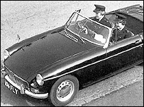 Policewomen driving and MGB in 1963