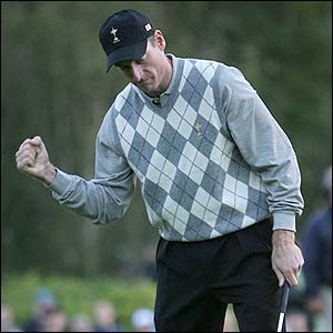 Jim Furyk celebrates winning the first