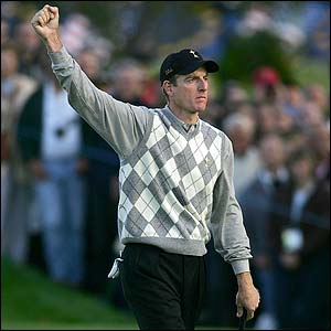 Furyk celebrates after sinking a putt on the ninth
