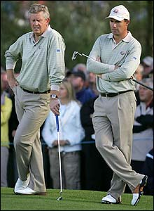 Montgomerie and Harrington contemplate their situation on the green