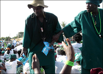 Officials hand out water at a rally