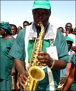 Jammeh supporter playing the saxophone