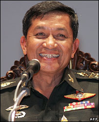 Gen Sonthi Boonyaratglin smiles at a press conference