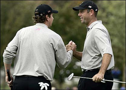 JJ Henry and Stewart Cink celebrate after earning a half against Paul Casey and Robert Karlsson
