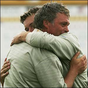 Lee Westwood and Darren Clarke embrace after beating Phil Mickelson and Chris DiMarco