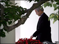 President Bush walks from the Oval Office as he departs the White House, Thursday, Sept. 21, 2006, for a trip to Florida