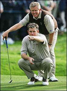 Westwood and Montgomerie check the line of a putt