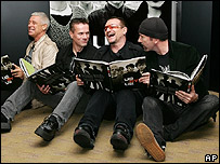 U2 pose with their book