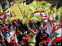 Hezbollah supporters wave flags