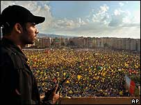 Hundreds of thousands of Hezbollah supporters wave flags in Beirut