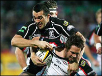 Ulster's Isaac Boss (right) is tackled by Jon Thomas
