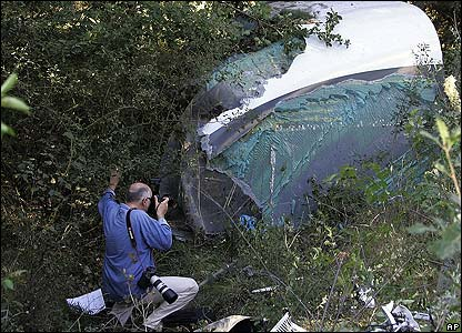 A photographer near some of the wrecked train