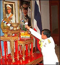 Gen Sonthi prostrates himself before a portrait of the king