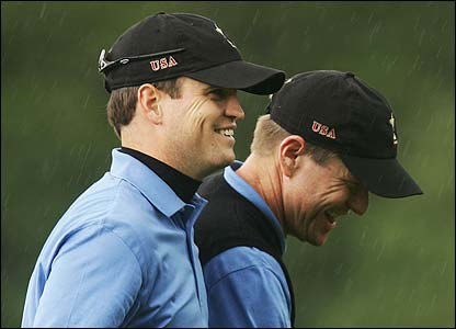 Johnson and Verplank smile on the green