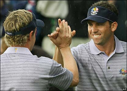 Luke Donald and Garcia celebrate going two up