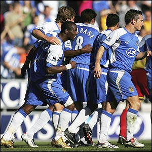 Henri Camara celebrates with Wigan team-mates