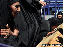 Relatives mourn those killed in a bomb blast