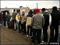 Illegal immigrants queuing