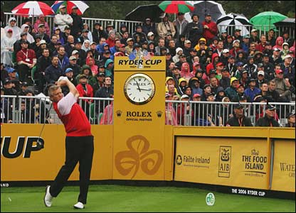 Colin Montgomerie tees off to a great reception from the rain-soaked crowd