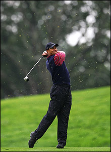 Tiger Woods hits a wood on the fairway