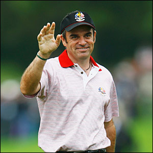 Paul McGinley receives applause after holing a putt