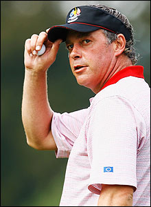 Darren Clarke doffs his visor to the fans