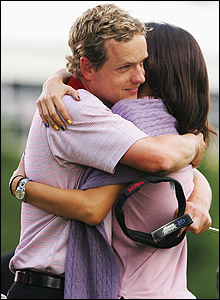 Luke Donald is congratulated by fiance Diane Antonopoulos
