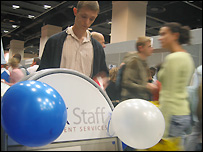 A man reading a sign at the Polish jobs fair