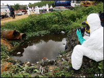 A photographer films a pool of the toxic waste in Abidjan, Ivory Coast