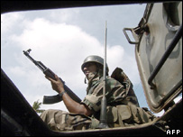 A Sri Lankan Army soldier rides atop an armoured personnel carrier