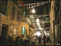 Lights illuminate a Cairo street decorated for Ramadan