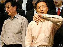 File photo of Chen Liangyu, right, with Han Zheng in 13 September 2004