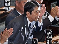 Shinzo Abe bows after being voted in as Japan's Prime Minister