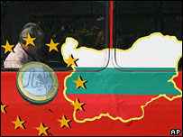 A bus window painted with the EU sign and a map of Bulgaria
