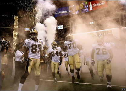 New Orleans Saints players take to the pitch amidst fireworks and celebrations