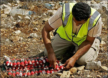 An explosives expert prepares to detonate a bomblet in Lebanon