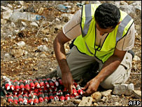 Explosives expert prepares to detonate cluster bombs in Majdal Sellem, south Lebanon