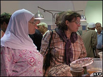 Tunisian women shopping for food in the capital, Tunis, on 24 September 2006