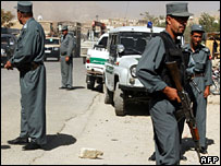 Police in Kabul at the site of an explosion