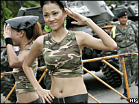 Thai girls dance to entertain the soldiers occupying the area around parliament Monday Sept. 25, 2006