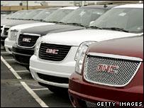 General Motors vehicles await sale at a GM dealership