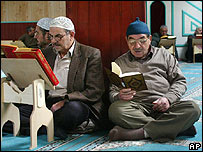 Turkish Muslim men read the Koran at a Berlin mosque