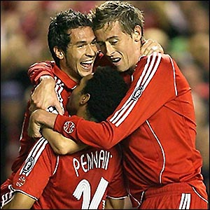 Luis Garcia (left) celebrates Liverpool's second goal as the hosts start brightly